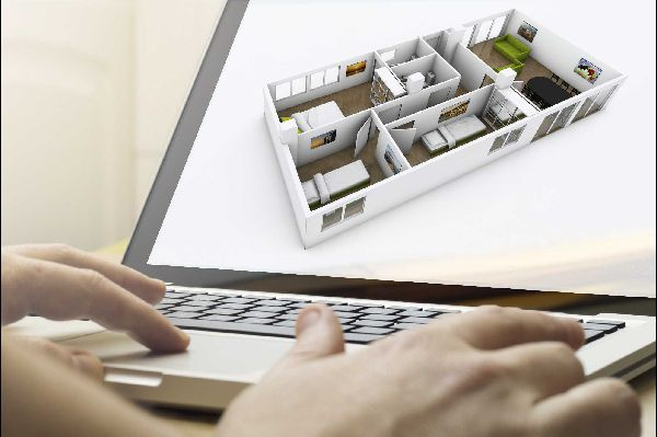 hands typing on the keyboard of a laptop computer with the image of a 3d floor plan on the screen